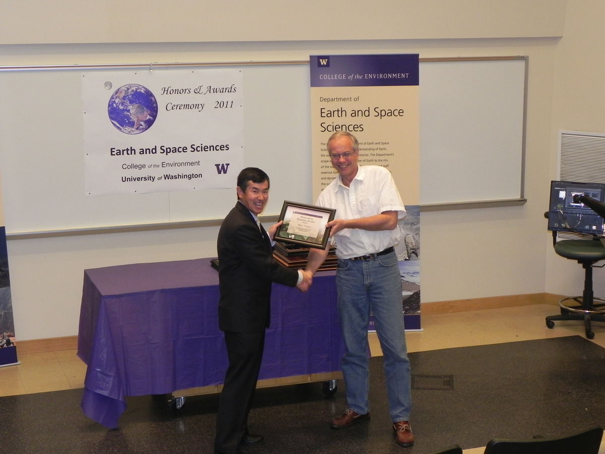 Photo of Bruce Nelson receiving the College of the Environment Teaching Award.