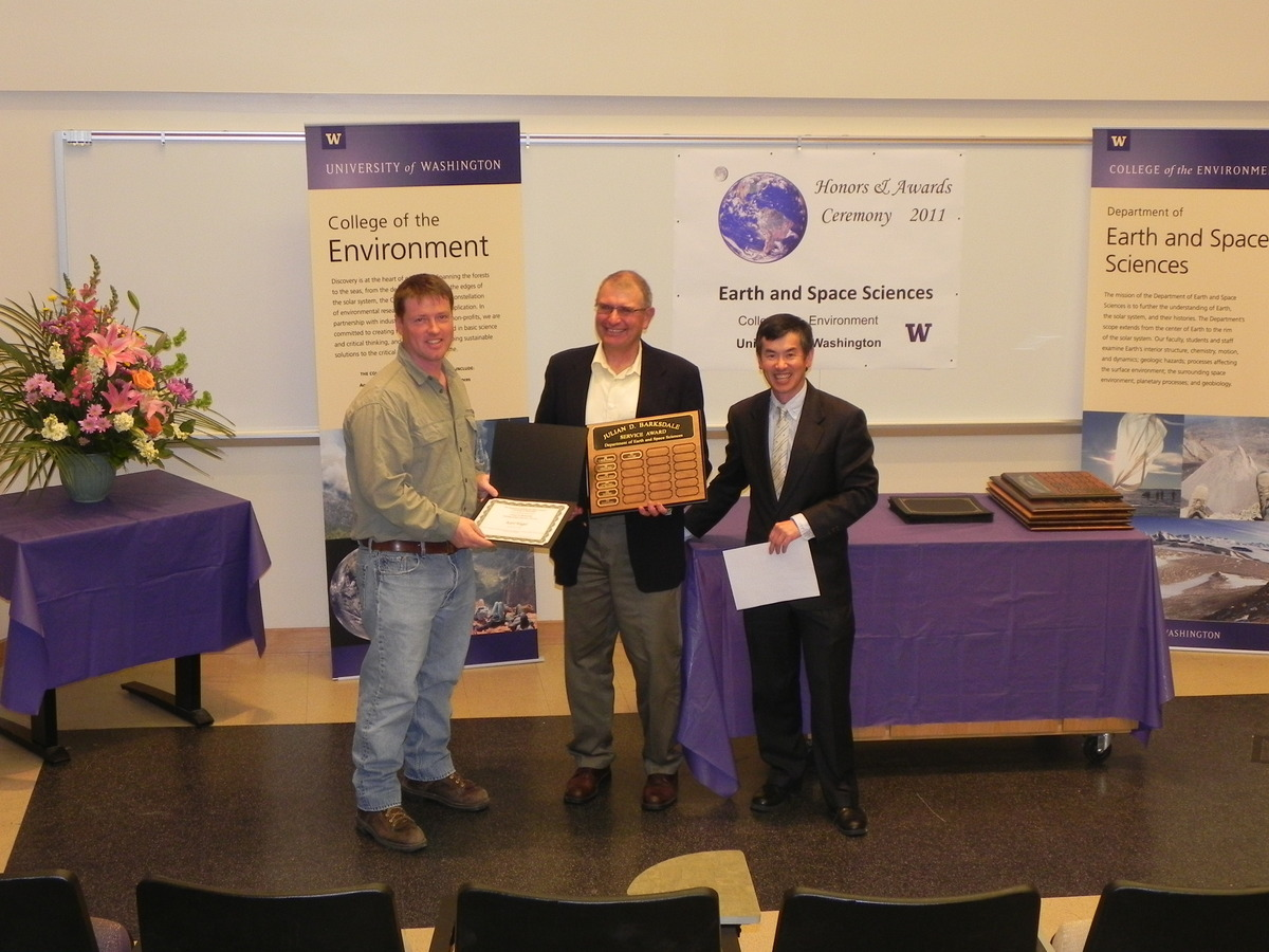 Photo of Karl Hagel receiving the Barksdale Service Award.