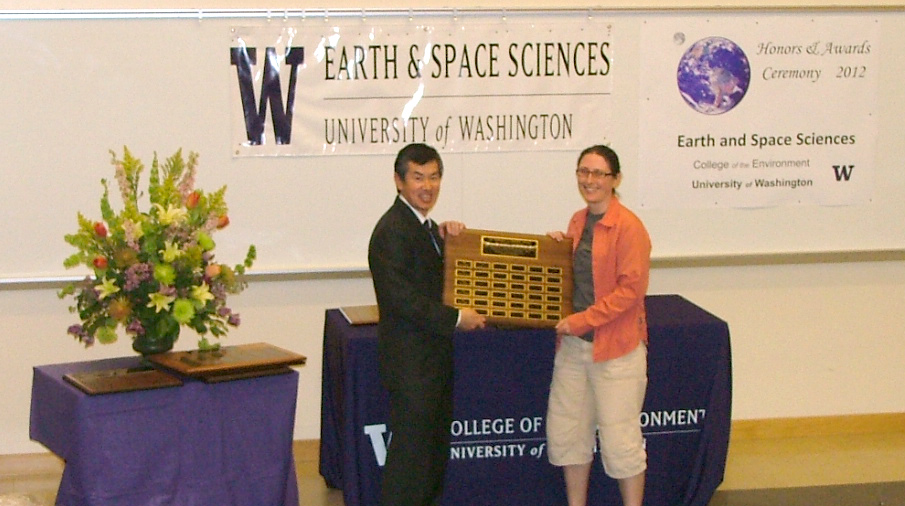 Photo of Aurora Burd receiving the Coombs Excellence in Teaching Award from Robert Winglee.