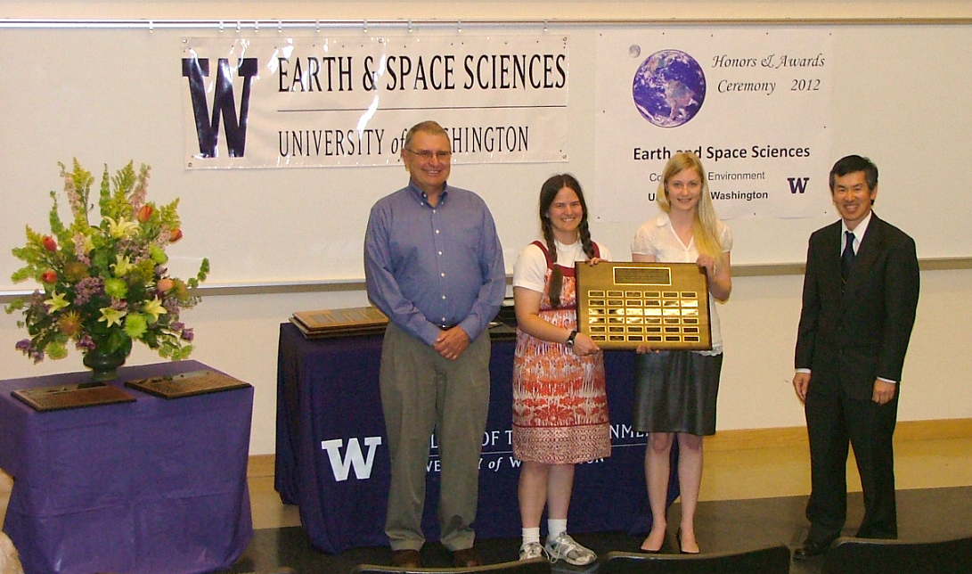 Photo of Danielle De Montigny and Sara Mickelberry receiving the Undergrad Service Award from Robert Winglee and Tucker Barksdale.