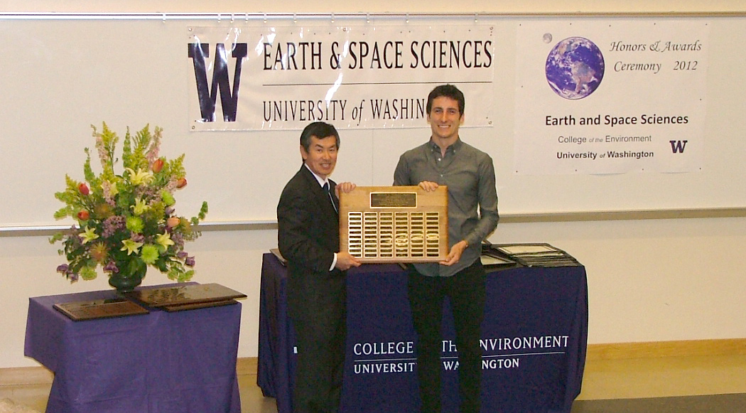 Photo of Erik Fredrickson receiving the Merrill Prize for Excellence from Robert Winglee.