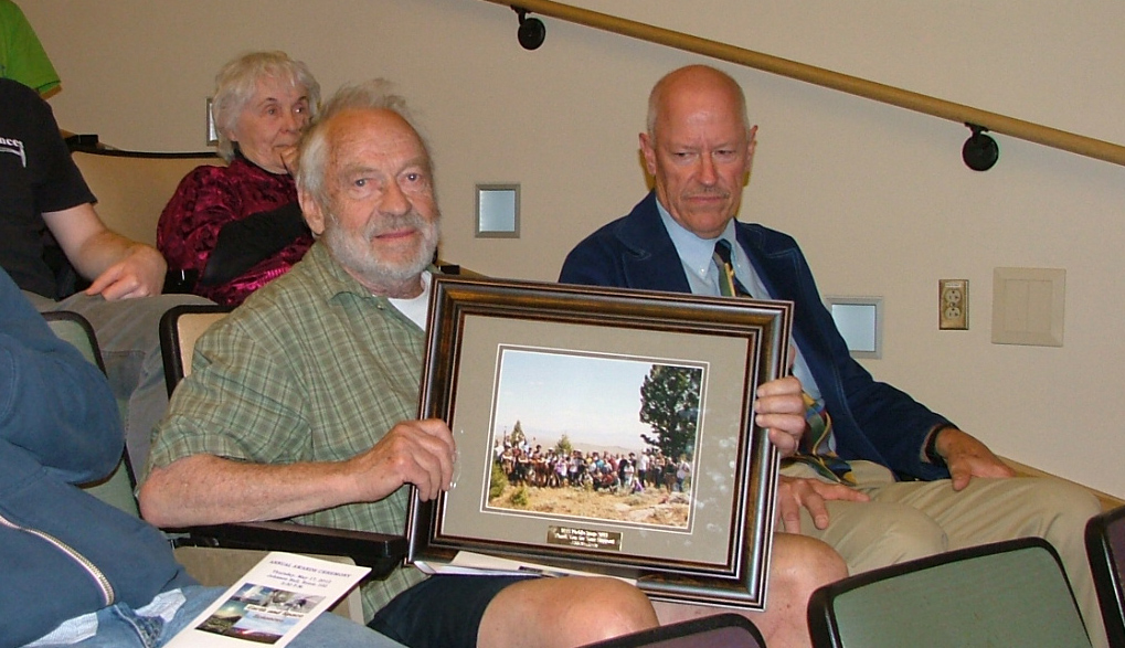 Photo of Joe Vance receiving a special recognition of dept service award.