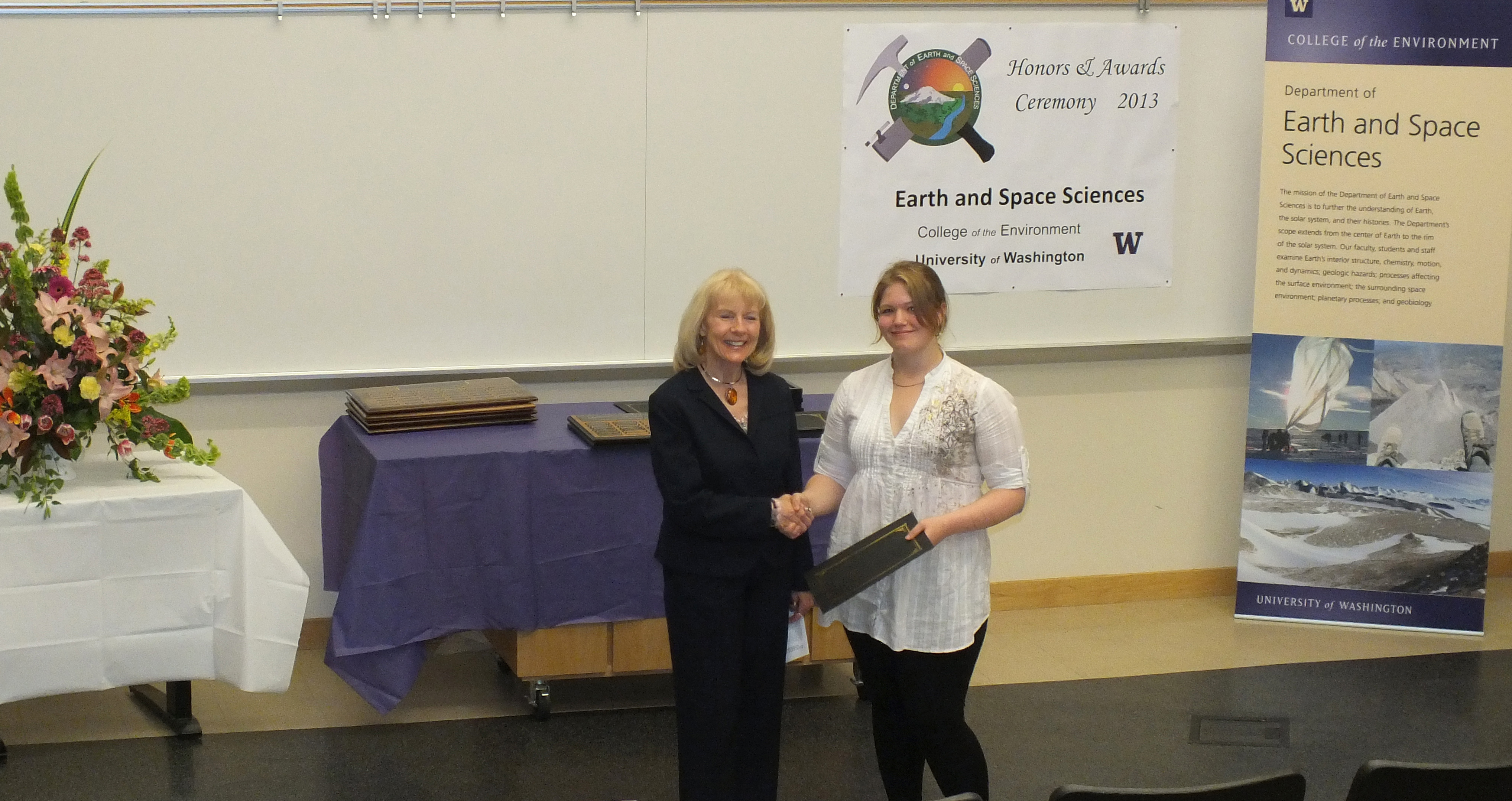 Photo of Reanne Wolfley receiving the North Seattle Lapidary & Mineral Club Award from Marcia Skinner.