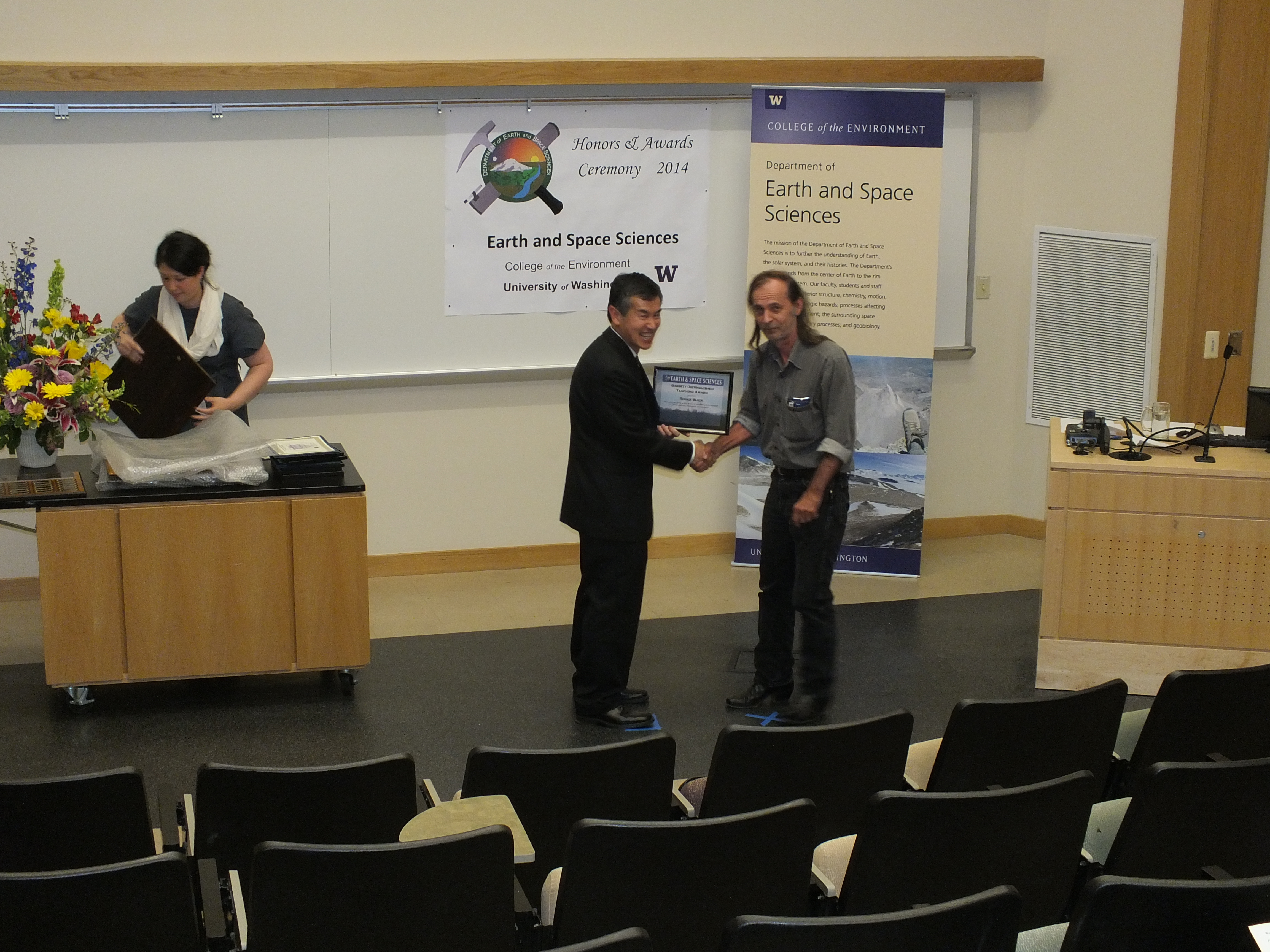 Photo of Roger Buick receiving the Faculty Teaching Excellence Award.