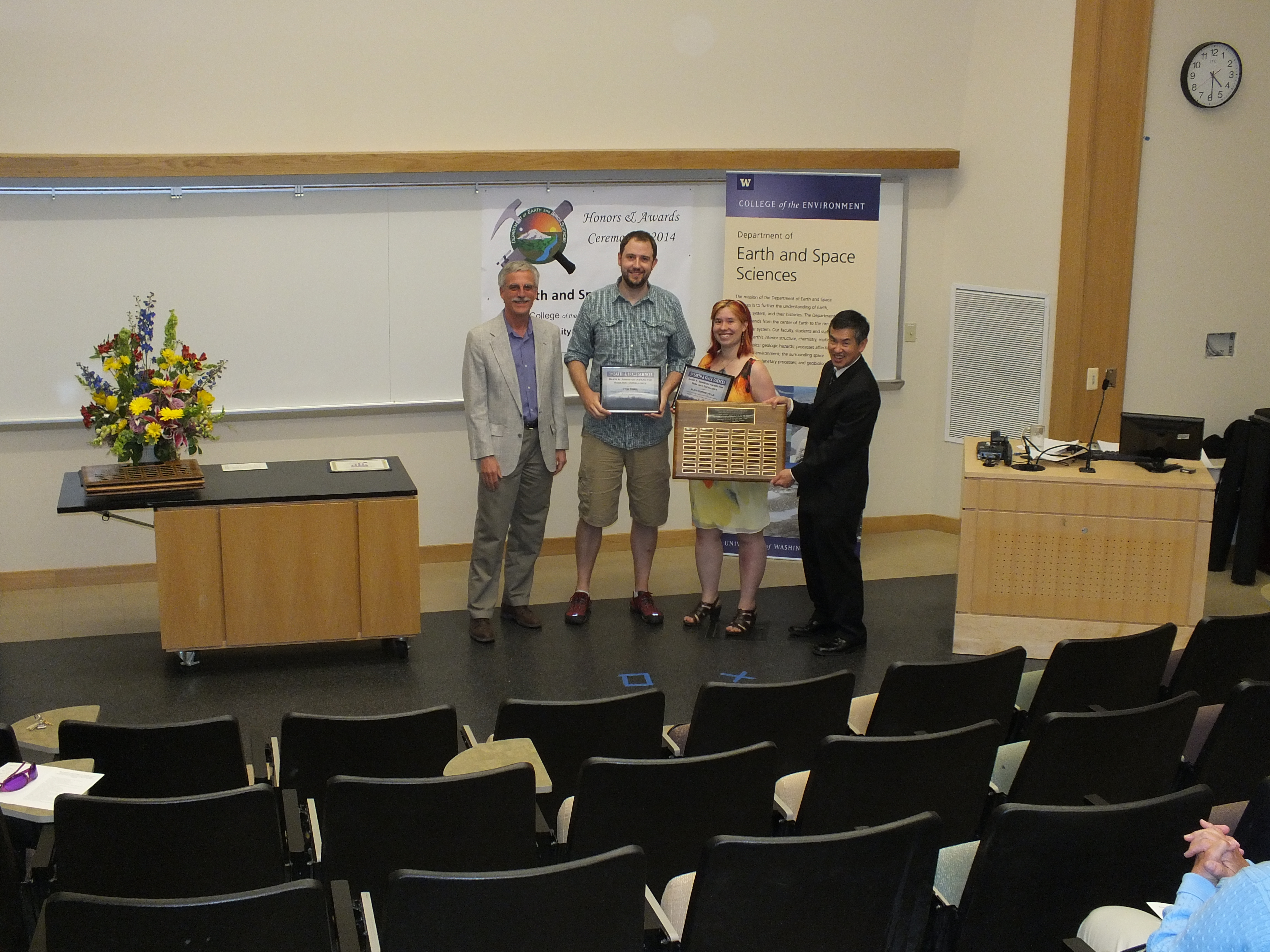 Photo of Alicia Hotovec-Ellis and Tom Tobin receiving the Johnston Prize for Research Excellence.