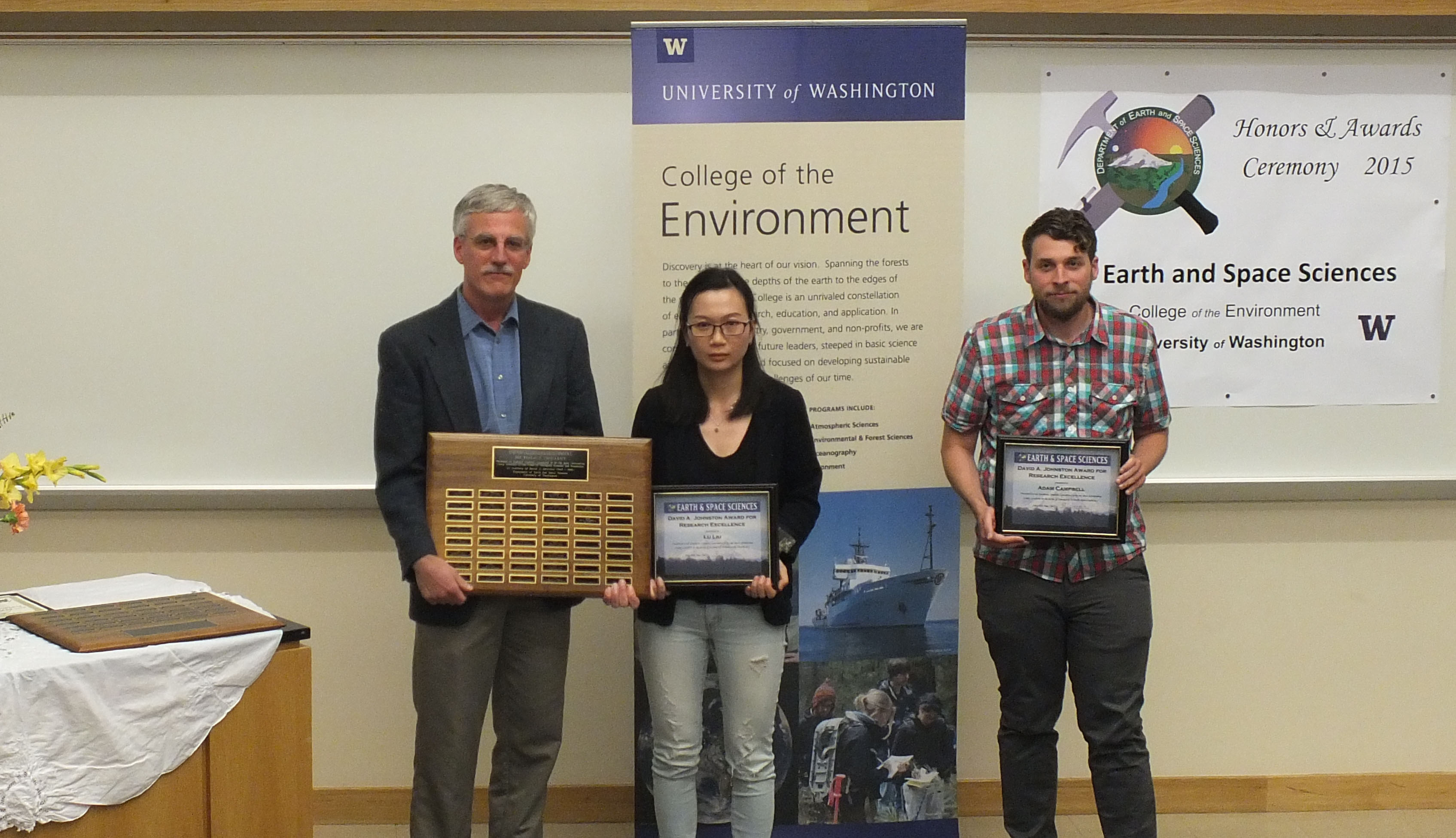 Photo of Adam Campbell and Lu Liu receiving the Johnston Prize for Research Excellence.
