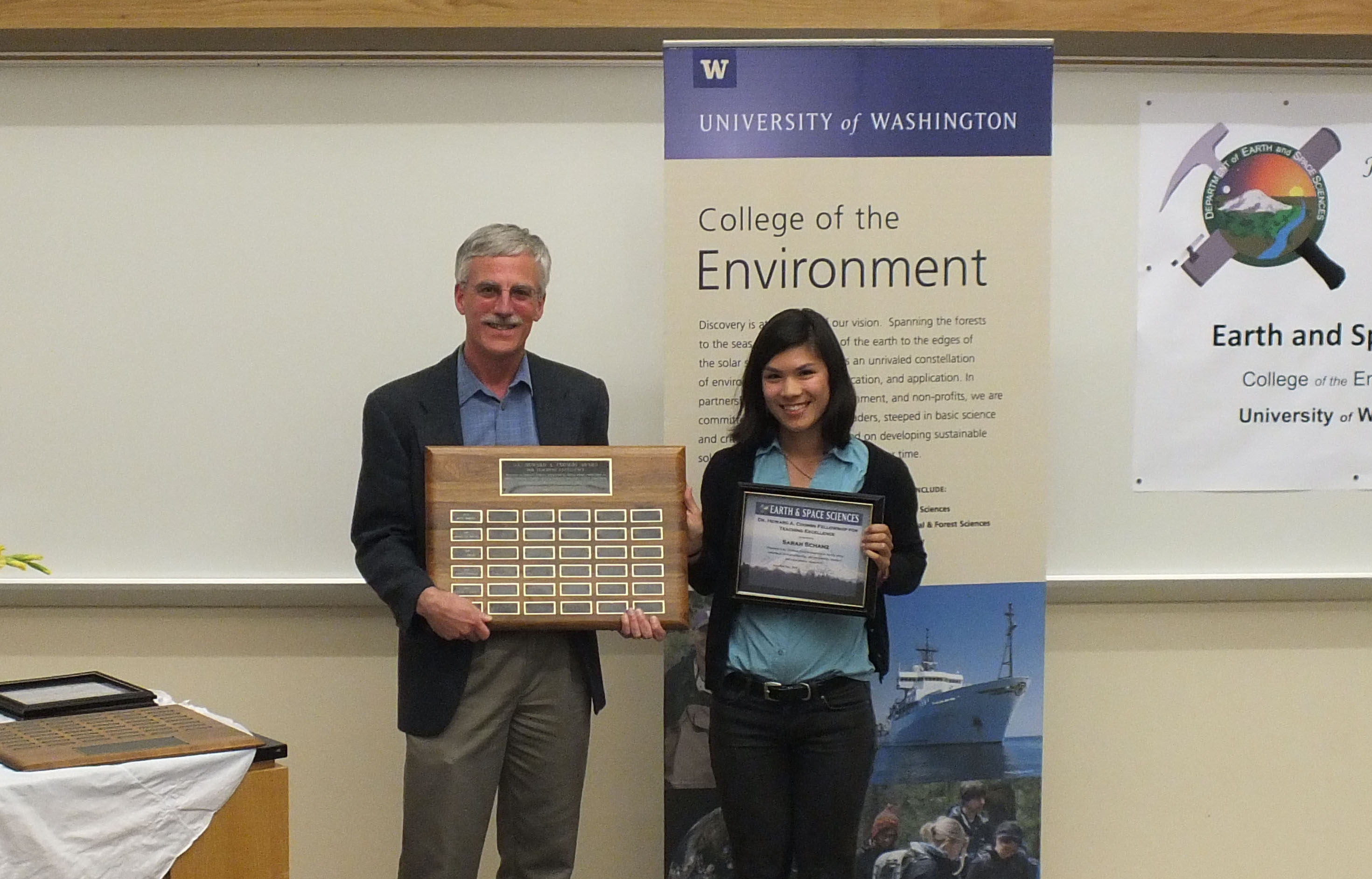 Photo of Sarah Schanz receiving the Coombs Excellence in Teaching Award.