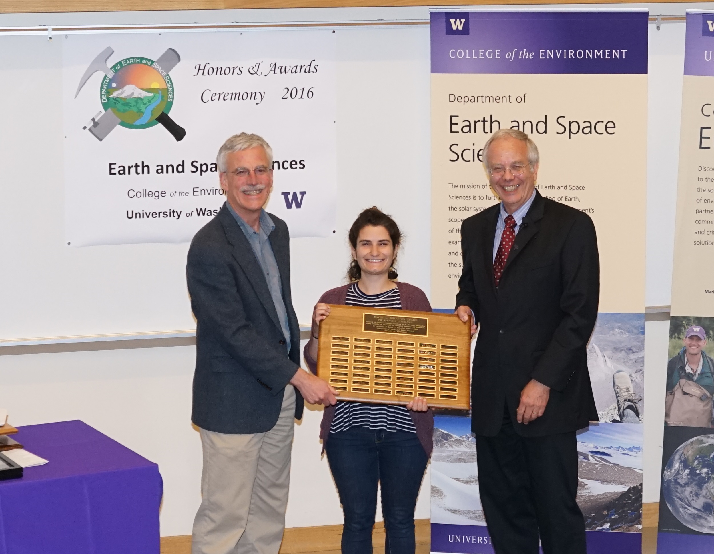 Photo of Elena Amador receiving the Johnston Prize for Research Excellence from Ken Creager and Bruce Nelson.
