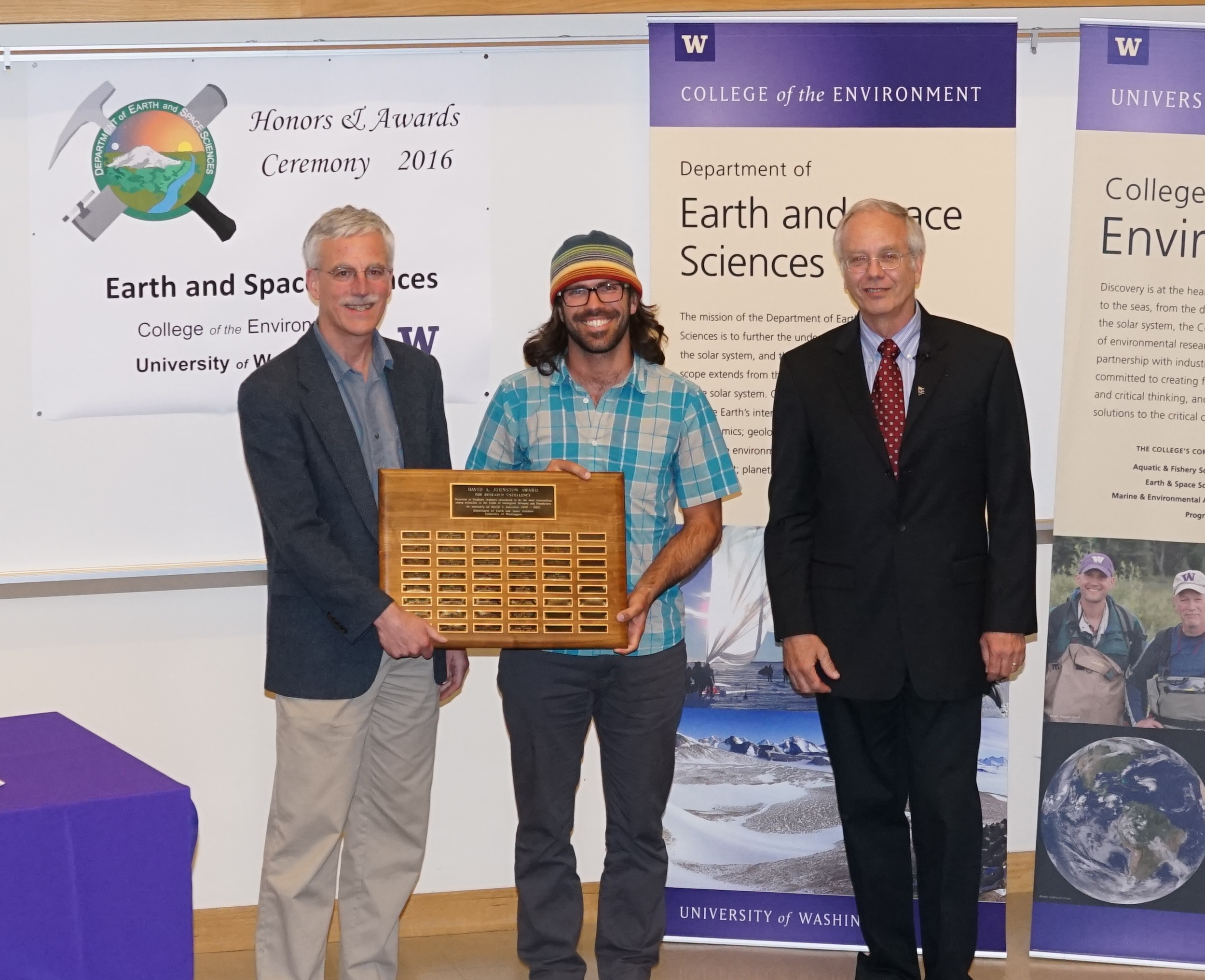 Photo of Bradley Markle receiving the Johnston Prize for Research Excellence from Ken Creager and Bruce Nelson.