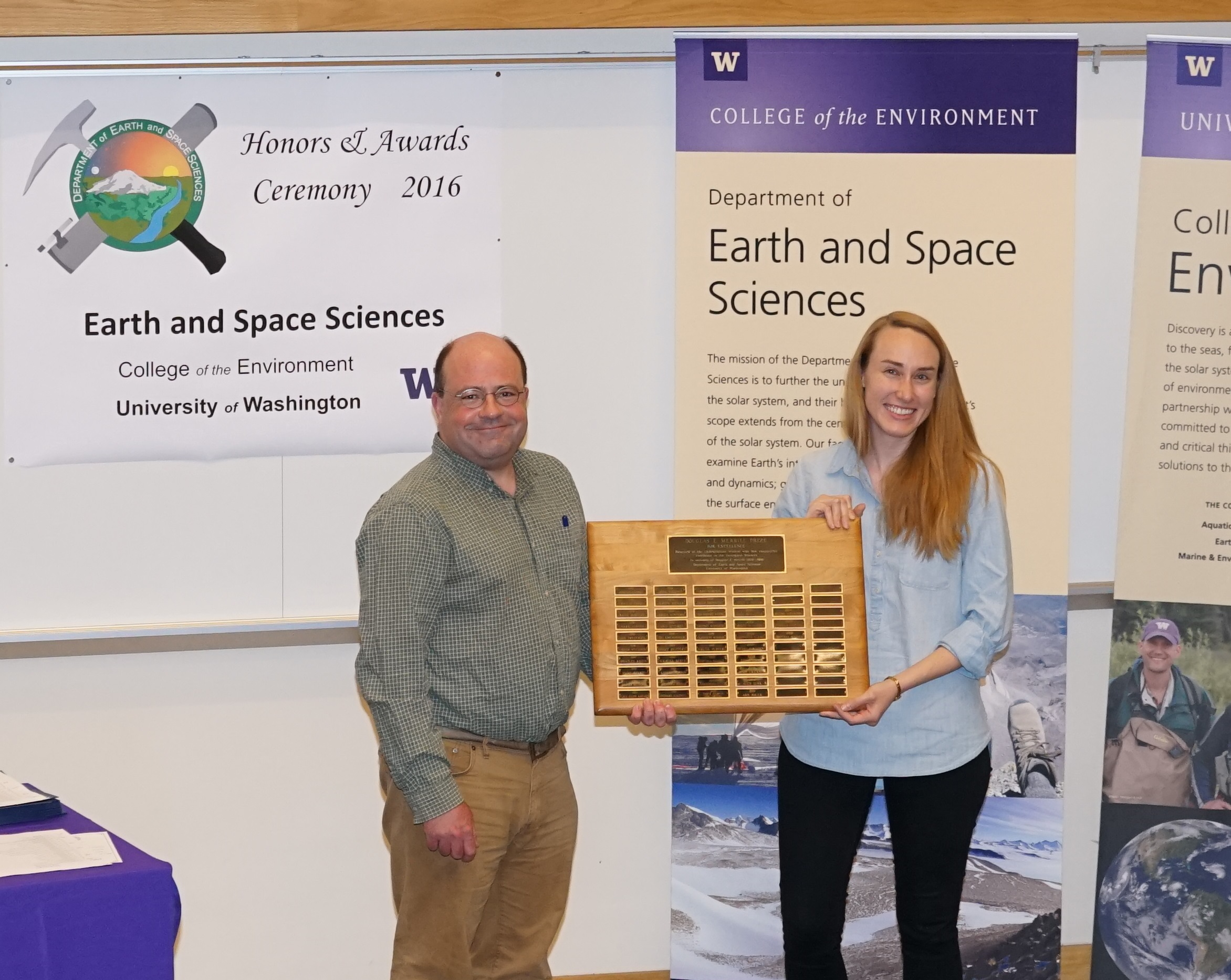 Photo of Brittany McManus receiving the Merrill Prize for Excellence from Gerard Roe.