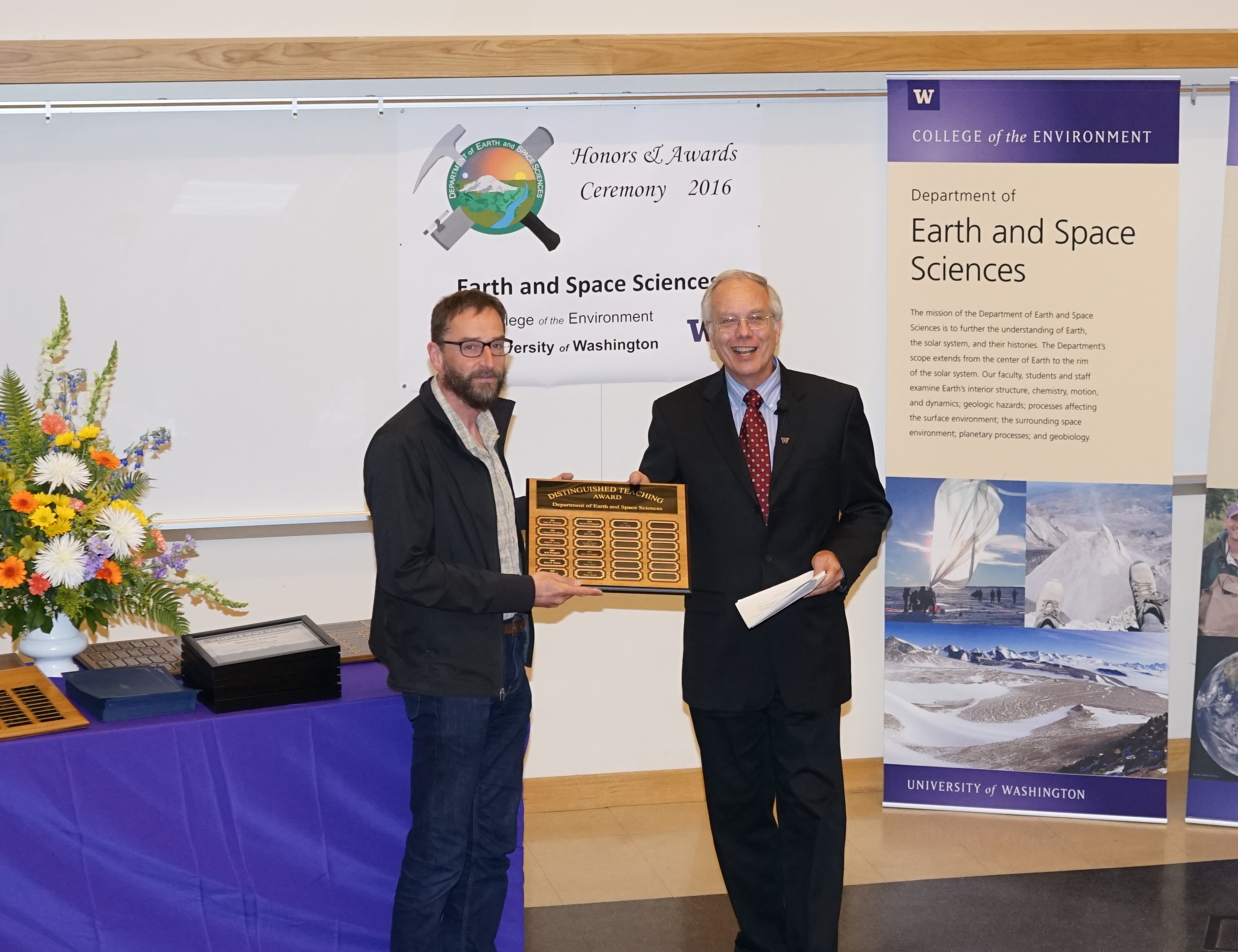 Photo of Eric Steig receiving the Bassett Faculty Teaching Excellence Award from Bruce Nelson.