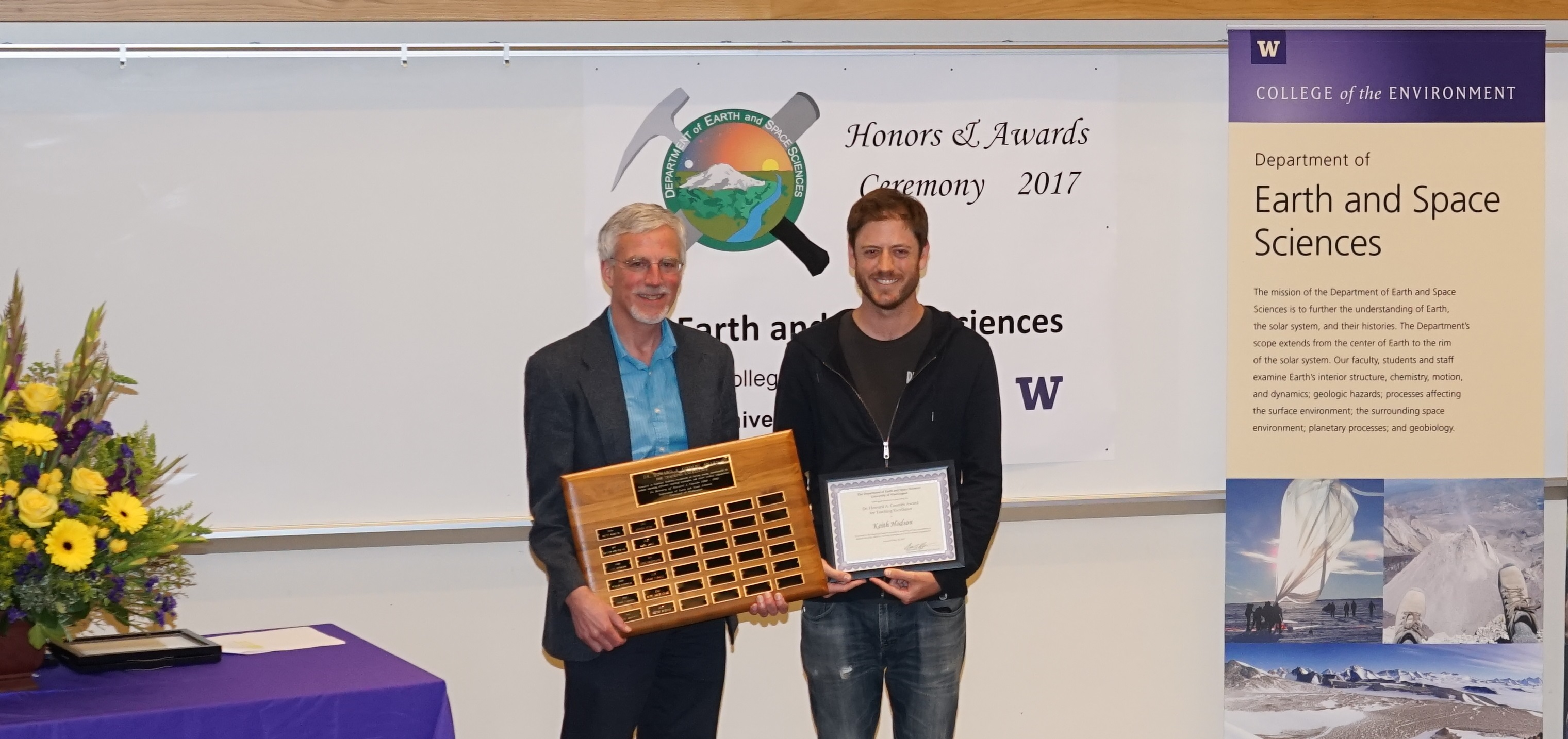 Photo of Keith Hodson receiving the Coombs Fellowship for Teaching Excellence from Ken Creager.