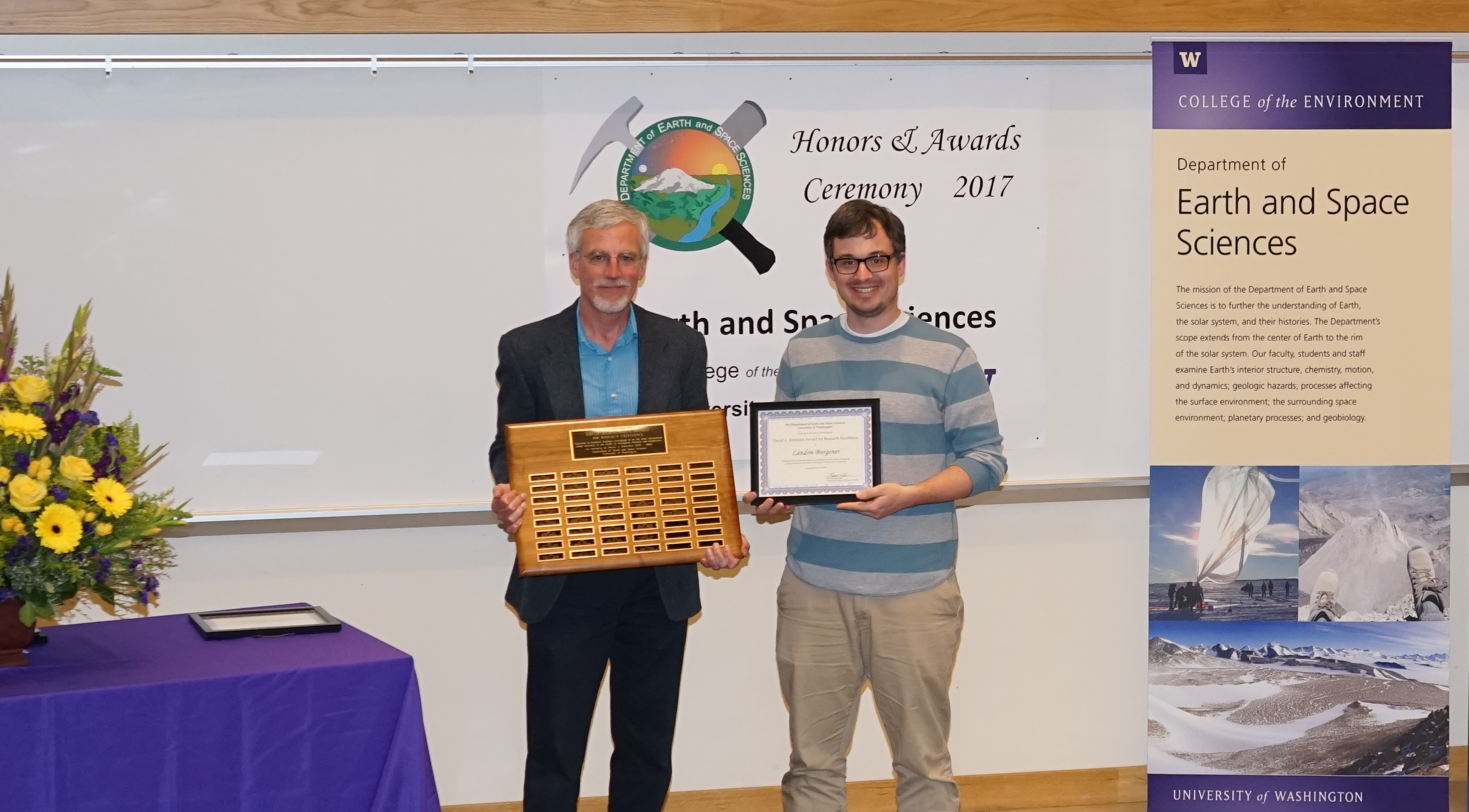 Photo of Landon Burgener receiving the Johnston Prize for Research Excellence from Ken Creager.