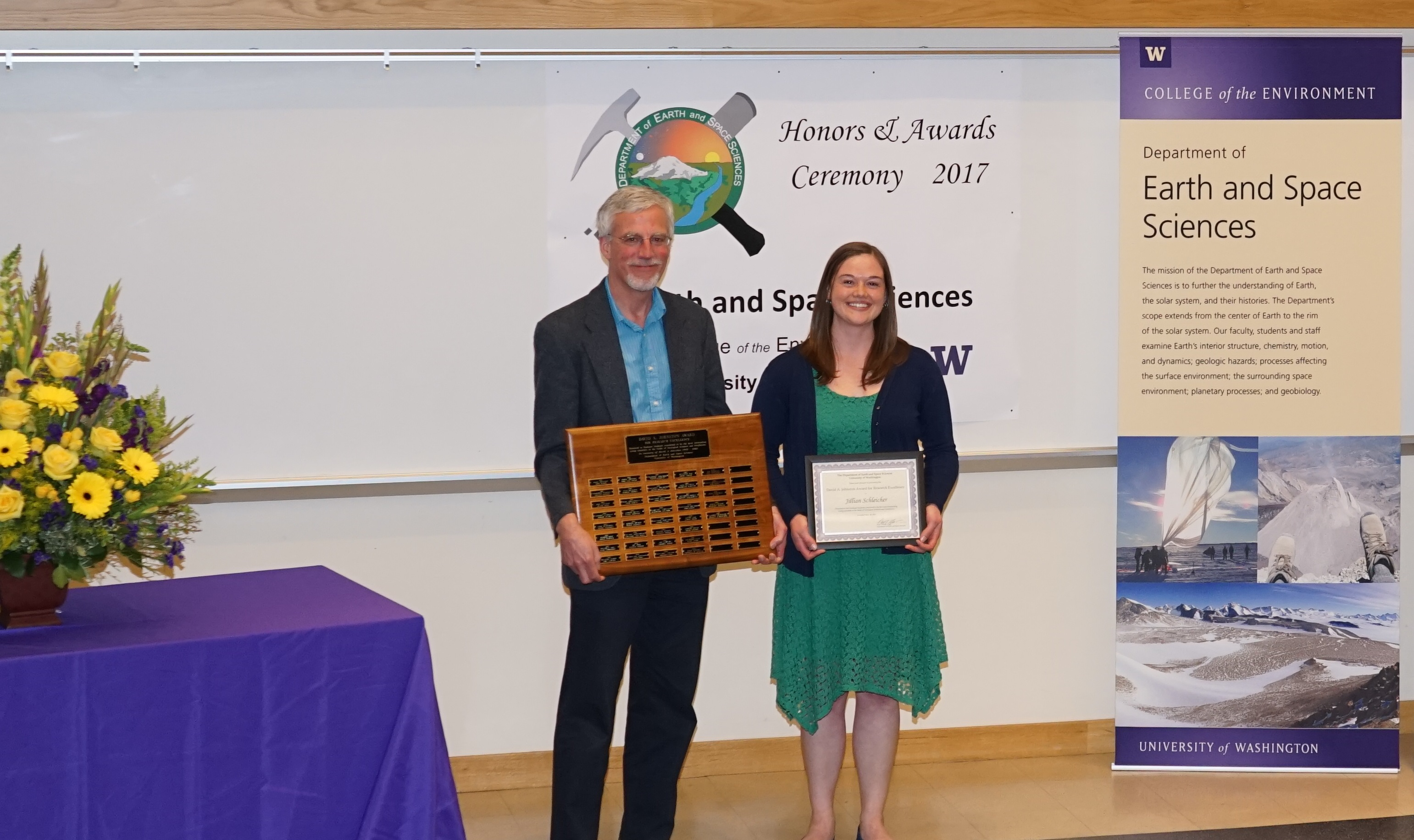 Photo of Jillian Schleicher receiving the Johnston Prize for Research Excellence from Ken Creager.