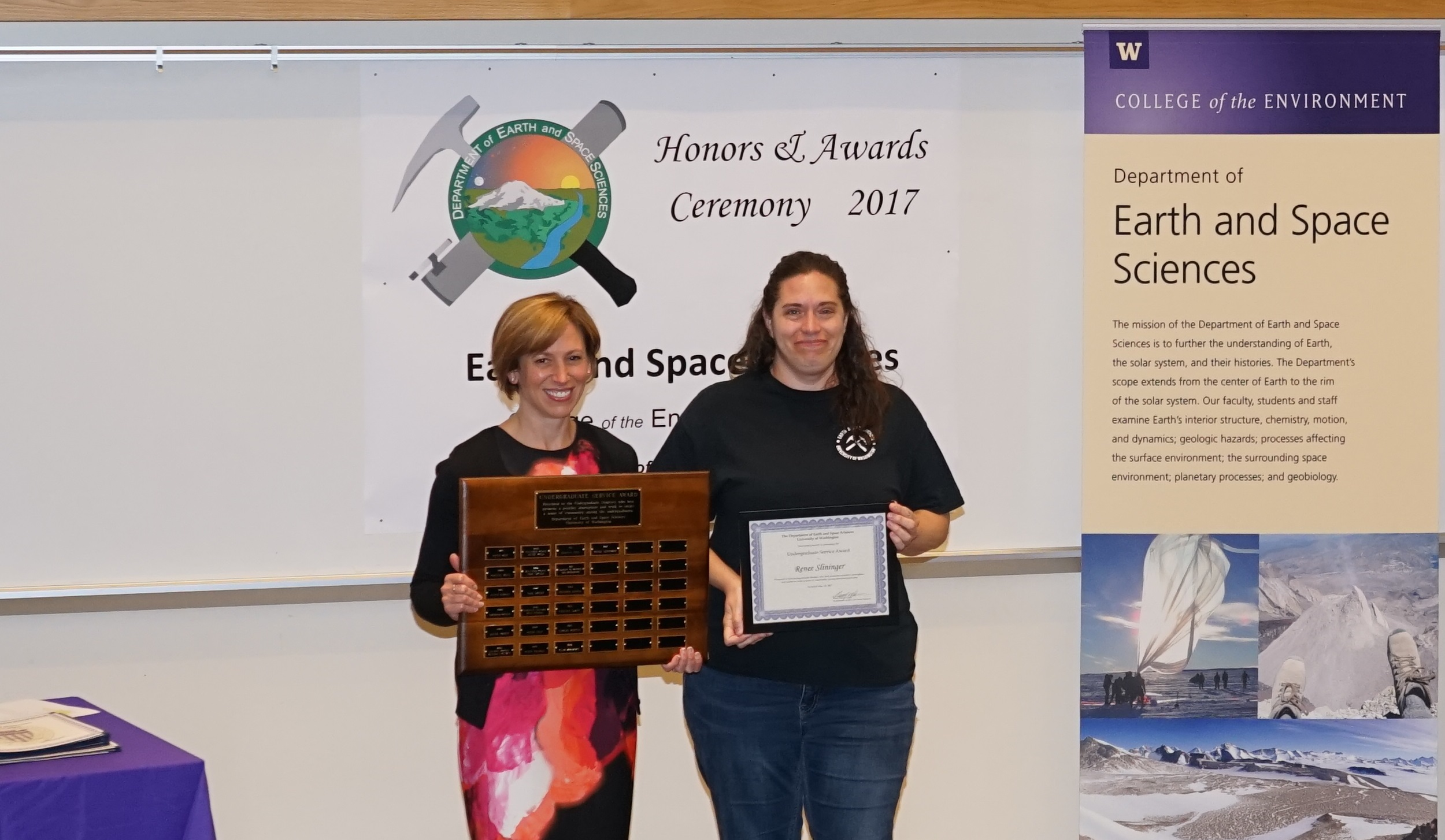 Photo of Renee Slininger receiving the Undergrad Service Award from Kate Huntington.